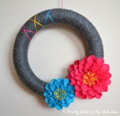 Dahlia Yarn Wreath ~ Perfect for summer! www.oneshetwoshe.com #wreath #crafts