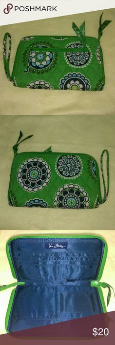 """Vera Bradley wrislet This is a very Gently Loved Vera Bradley wristlet wallet. Zipper front change pocket and plenty of room inside for cards, cash and all the other goodies we find to put in there! Measures 8""""x 5"""". No stains, no wear, EUC! A beautiful grass green. Vera Bradley Bags Clutches & Wristlets"""