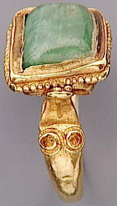 ring, gold with green stone, Merovingian, 6th c. (Saint-Germain-en-Laye.....just noticing this big eyed alien on this golden ring side.