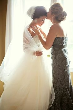 Taking the time to get photographs with your mom while you are getting ready can be very important to some brides. Have your photographer capture the emotional moment that is shared between the two of you.