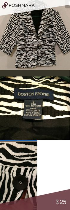 """Boston Proper Zebra Jacket Size 8 Boston Proper ladies fashion jacket. Beautiful zebra stripe on textured Polyester. Large 3 button with elastic loop for closure. 3/4 sleeve and lapel. Size 8. Across the chest is 19"""" and from the shoulder to the hemline is 23"""" Boston Proper Jackets & Coats"""