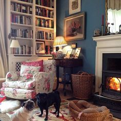 living room books bookcase fireplace gallery wall art painting
