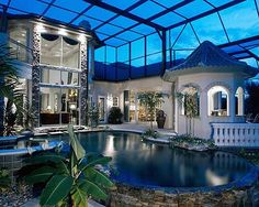With a covered pool like this, I'd be swimming every day! This has got to be in Florida--this is such the norm there.