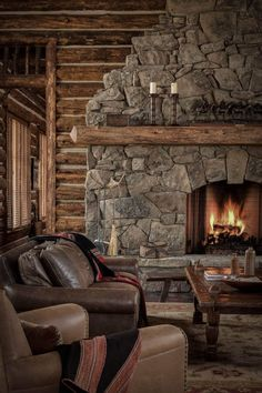 Montana Moss Rock fireplace and log and chink walls in a rustic mountain lodge near Alder, Montana. Cabin Fireplace, Rustic Fireplaces, Living Room With Fireplace, Stone Fireplaces, Fireplace Ideas, Modern Fireplace, Cream Fireplace, Living Rooms, Rustic Mantle