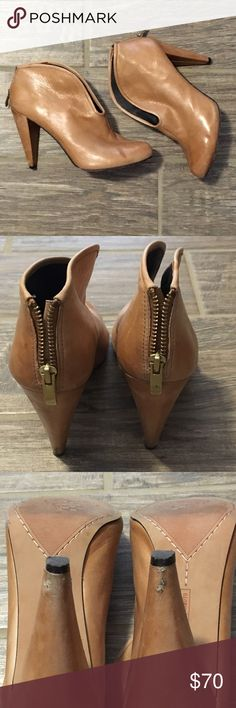 Vince Camuto Alexia Camel Booties Sexy zip-back booties that are gently used. Great condition with some minor scuffing on the heels. Price adjusted with that in mind. Sold as-is! Vince Camuto Shoes Ankle Boots & Booties