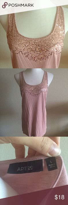Apt 9 Blush Sequin Tank Sleeveless Top She'll Gorgeous sparkle tank from Apt 9. Features sequins across the neckline. Sleeveless shell style, slight scoop neck and tank sleeve.  Solid on back. Jersey stretch material. Only worn ONCE! Runs a bit small Id say it fits like a 10. Apt. 9 Tops Tank Tops