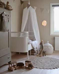 Baby Girl Nursery Room İdeas 406731410100868564 - Isn't this the most amazing kids bedroom idea? I'm absolutely loving this decor and design. And just look at the cute tepee, boho round floor rug and the pretty cot! Source by leylamayu