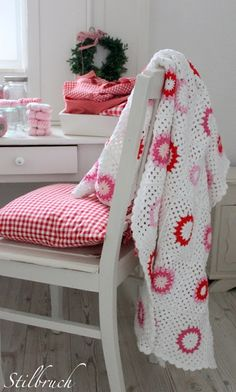 White and pink crochet throw