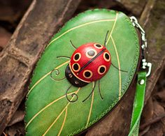 It's ready to ship-Leather ladybug coin purse - Hand dyed leather painted coin purse -  handmade leather 3D coin purse. $28.00, via Etsy.