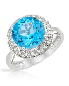 Gorgeous topaz surrounded by diamonds.