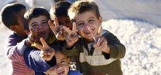 Image: Kurdish refugee children from the Syrian town of Kobani flash victory signs in a camp in the southeastern town of Suruc
