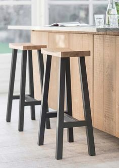 The classic design of the Rax black tall stool makes it a stylish addition to any kitchen, island or bar. With a beautiful moulded oak seat and long beech legs painted in contemporary carbon black wit Tall Stools, Rustic Stools, Island Stools, Stools For Kitchen Island, Wooden Bar Stools, Modern Stools, Wood Stool, Wooden Stool Designs, Diy Stool