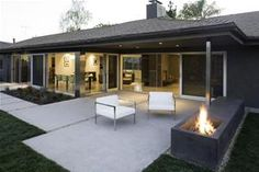 Patio features small concrete pads in modern design.   Modal Design Los Angeles, CA