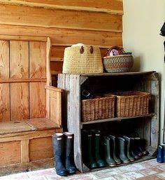 Mud room. I like the old pew, and room for lots of boots. Lord knows we have a LOT in our house!