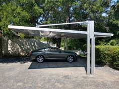 We specialize in shade covering systems that will import directly from Japan. Our modern carports aren't like anything else you will find in the states. Carport Sheds, Carport Plans, Carport Garage, Car Porch Design, Tent Design, Shed Design, Carport Canopy, Pergola Carport, Building A Carport