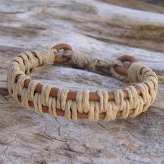 Tan leather 3mm cord with natural hemp.  This Tan Leather and Natural Hemp Bracelet is adjustable, fits 6-8 inch, 15-21cm wrist and is 13mm wide by 5mm thick.