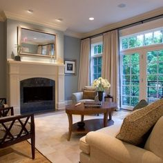 Classy homey living room.  Love the floor to ceiling windows and drapes