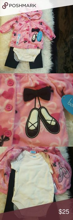 Nwt, 3piece, soft, snuggel set This 3piece outfit will dance right into your heat. This outfit includes an adorable, soft pink button up, hooded jacket with tap shoes embroidered on it. The pattern is hearts and bows. There's also a white onsee and black fleece pants to complete the look. This outfit fits 3/6months. Snuggel your future dance up in the cozy, georgious set. Bon Bebe Matching Sets