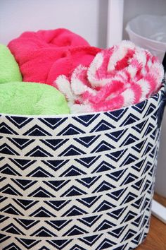 Basket for Blankets | Refresh your teen's bedroom to last! Add modern touches in fresh colors with pops of fun! Sophisticated and modern, its sure to last until college! | Sumptuous Living | http://sumptuousliving.net/modern-teen-bedroom/