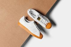 """KIX & LIDZ: adidas Originals Superstars 80's DLX """"White...The adidas Superstars is getting a proper treatment for the summertime with a new colorway that is as classic as the model. White leather takes on the upper build of the sneaker, while a gum sole that extends to the Shelltoe rounds things out. The contrast of the smooth white leather and the gum sole adds for a luxurious feel for a decent price point. A gold Trefoil adidas logo adds on to create a neat detail to a rather simple…"""