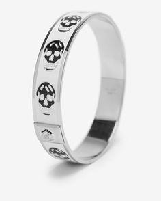 Love this!  Too bad it's $260, lol!    Alexander McQueen Small Enamel Skull Cuff: White/ Black