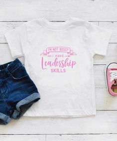 Im Not Bossy I Have Leadership Skills Toddler Shirt. This shirt is a great gift and sure to get a laugh.  *When ordering: SS = Short Sleeve, LS = Long Sleeve *Bodysuits are Carter's brand. Please see their sizing chart if you aren't sure what size to order. *All bodysuits are white. The color you