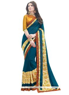 Rich look attire to give your a right choice for any party or function. Be the sunshine of anyone's eyes dressed with this interesting teal georgette designer saree. The ethnic patch border work to ...