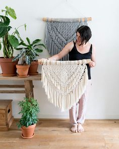 Macrame Wall Hanging - Made to Order Expected delivery 1-2 weeks! ▴ D E S C R I P T I O N This Wallhanig is made on Liana wood and handcrafted with freehand patterns so the end result is always unique. This wall hanging will give your home that extra Bohemian feel. Made with natural cotton string cord. Please note, this piece is made to order, so there may be a slight variations from the photo. ▴ D I M E N S I O N S Wooden dowel length : 71cm - ( 28 inches ) Macrame Width : 60cm ( 23,5 i...