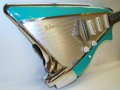 Uber Cool - Vintage Car Bass guitar - Looks like a fin of of a Caddie...looks like 6 strings to me