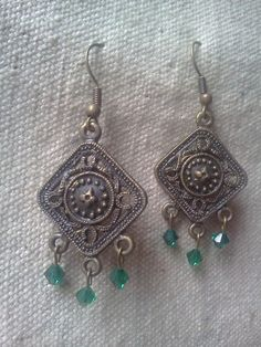 '2 pairs Beautiful Metalwork and Crystal Earrings!' is going up for auction at 12pm Sun, Jul 22 with a starting bid of $5.