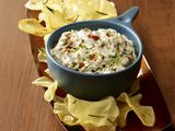 Roasted Garlic-Bacon Dip | Recipe Courtesy of Food Network Magazine, for 50 Game-Day Dips | Onion dip gets dressed up for the big game with garlic and bacon. | From: foodnetwork.com |
