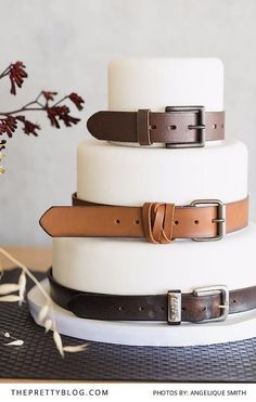 White fondant wedding cake with brown leather belts   Photograph by Angelique Smith   Cake by Cakes by Wade  