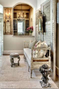 love the old shutters behind the bench and the shutter with a sconce attached.