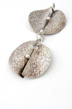 Elis Kauppi, Kupittaan Kulta Finland - textured silver kinetic pendant