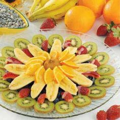"""This """"floral"""" arrangement has a light pineapple dressing HARPER'S NOTE: I substitute lemonade concentrate for the pineapple juice=less sweet, and add halved pineapple rings into the fruit Creamy Fruit Salads, Tropical Fruit Salad, Fresh Fruit, Fruit Decorations, Food Decoration, Fruit Recipes, Cooking Recipes, What's Cooking, Salad Design"""