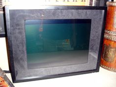 """I made this for my parents. It is an old laptop running slickr that I turned into a digital picture frame. Whenever I add new photos to my """"picture frame"""" set they show up in the rotation. They really loved it. It probably cost me about $140 to build """"Fun colorful photo frames for a very low price.  These make great gifts for just about anyone."""""""