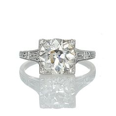 Art Deco engagement ring on Leigh Jay Nacht Inc (I like the round diamond in a square setting)