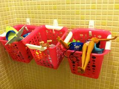 Dollar store bins, waterproof command strips = wonderful bathroom toy storage. Drilled extra holes in the bottom for drainage.