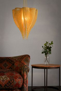 LOVE CLOVERS A four leaf clover design translated into a voluptuous and sensual heart shaped pendant lamps. Wall Lantern, Lantern Pendant, Pendant Lamps, Spiral Tree, African Design, Flower Of Life, Tree Art, Wind Chimes, Heart Shapes