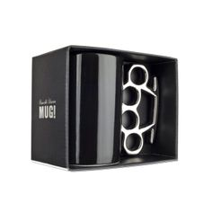 The original Knuckle Duster Mug - Accept no cheap imitations.Hand made from quality porcelain, this large mug with a knuckle duster / brass knuckles shaped handle will ensure your coffee packs a punch. Homeware Uk, Coffee Pack, Brass Knuckles, Novelty Mugs, Dusters, Deco, Black Silver, Handmade, Kaffe