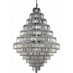 Swarovski Elements Crystal. Breathtaking while remaining refined, Maxime collection hanging fixtures sparkle in a mosaic of crystal tiles. Square and rectangular precision-cut crystals form the exterior of extravagant tiers. A mischievous asymmetrical hanging tube adds a touch of whimsy to the startling beauty of these lamps.#furniture#livingroomfurniture#homeinterior#homedecor#chandelier#affiliate Luxury Chandelier, Chandeliers, Home Decor Lights, Egyptian, Mosaic, Swarovski, Bulb, Sparkle, Ceiling Lights