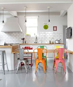 Multi-color tolix chairs in dining room