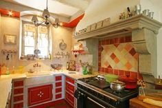 French Country Kitchen with Cupboard Panels Painted Red