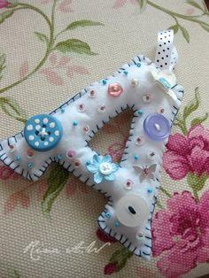 Button decorated felt letters