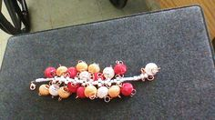 This is red, gold, and silver, mesh spacer beads woven bracelet