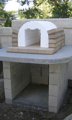Applying the first layer of firebrick to the Mattone Barile Wood-Fired Brick Pizza Oven foam form