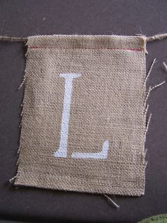 diy burlap banner- I like the way they sewed this one so the letters can be interchangeable in the future.