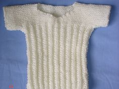 Beautiful hand knitted baby singlet
