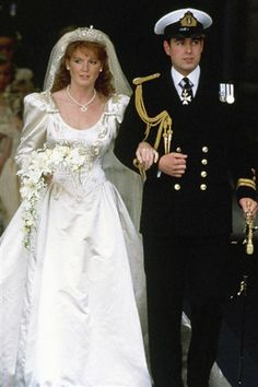 On July 23, 1986 Miss Sarah Ferguson married HRH Prince Andrew. Her wedding gown was made of duchesse satin with a 17-foot train which featured an anchor to represent Prince Andrew's time in the navy and an 'A' was also embroidered onto it to reflect her love for her husband. The couple had two daughters, Beatrice and Eugenie. They separated in 1992 and divorced in 1996. Neither have remarried.