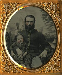 Simply beautiful sixth plate ruby ambrotype of a Federal cavalry trooper seated with his young daughter. Dressed in his cavalry jacket he cradles the child in his lap while she grasps onto his finger. Perhaps as a reminder for her later in life should he not return. Absolutely pristine view of this steely eyed horse soldier. In a short matter of time he would be engaged in the life and death struggle of war yet here he displays the delicate touch of a loving father to his young child.